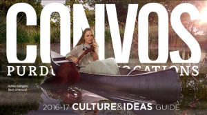 Ashley Bathgate paddling a canoe with a cello