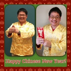 Wearing Tang Suit and holding red envelope