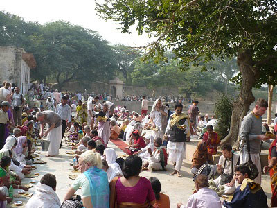 devotees honor prasad