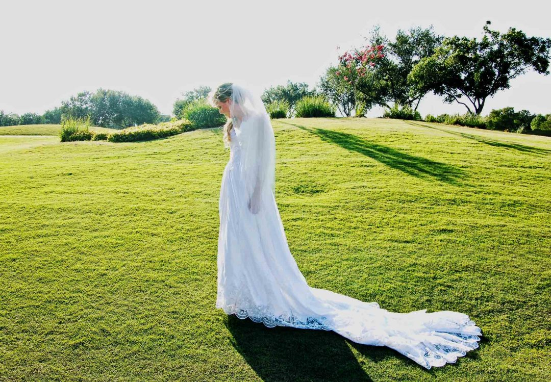 wedding bride pose sideways on field