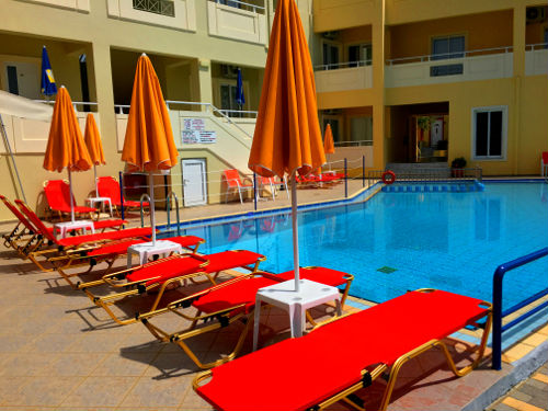 gold and red poolside lounge chairs in Platanias