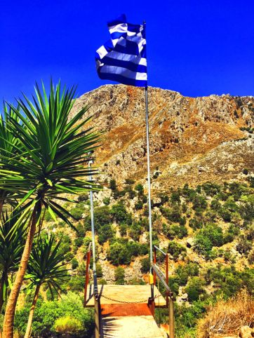 greek flag flying at taverna romantza