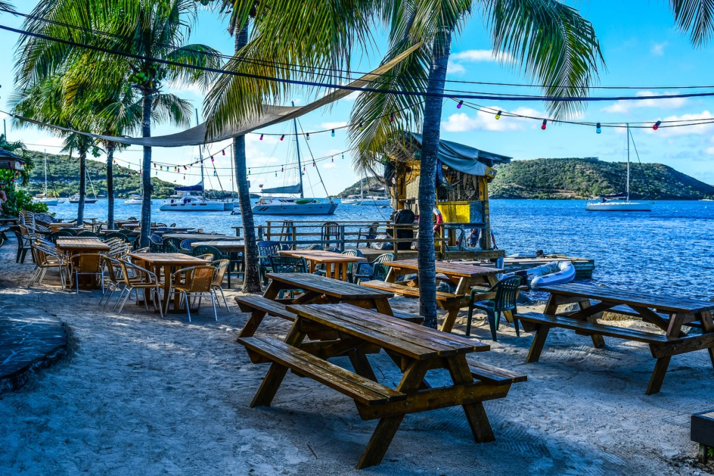Evening breezes sway the palms on this idyllic beach setting at a beachside bar