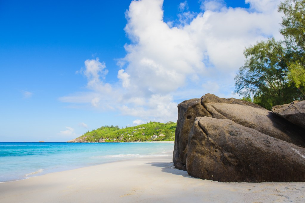Paradise view of Seychelles beach with rocks and big stones. Tropical nature on island.