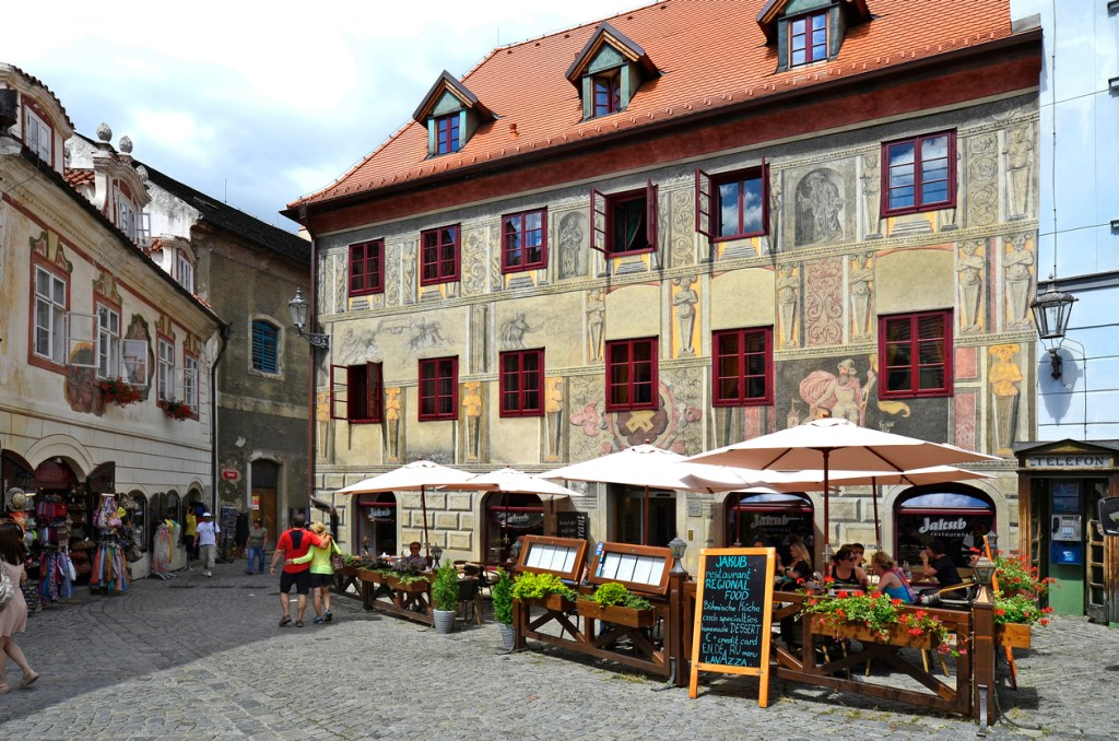Restaurant and house with decorated facade in the Unesco World Heritage Cesky Krumlov