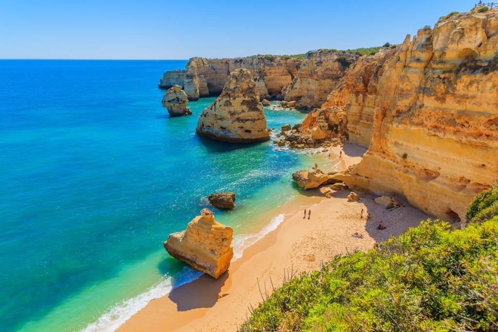 View of beautiful Marinha beach with crystal clear turquoise water near Carvoeiro town, Algarve region