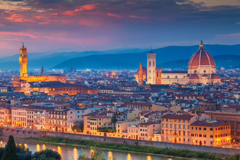 Cityscape image of Florence, Italy during dramatic sunset.
