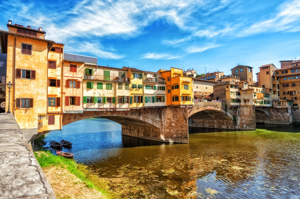 The Ponte Vecchio, or Old Bridge, is a medieval stone arched bridge over Arno river in Florence, Italy