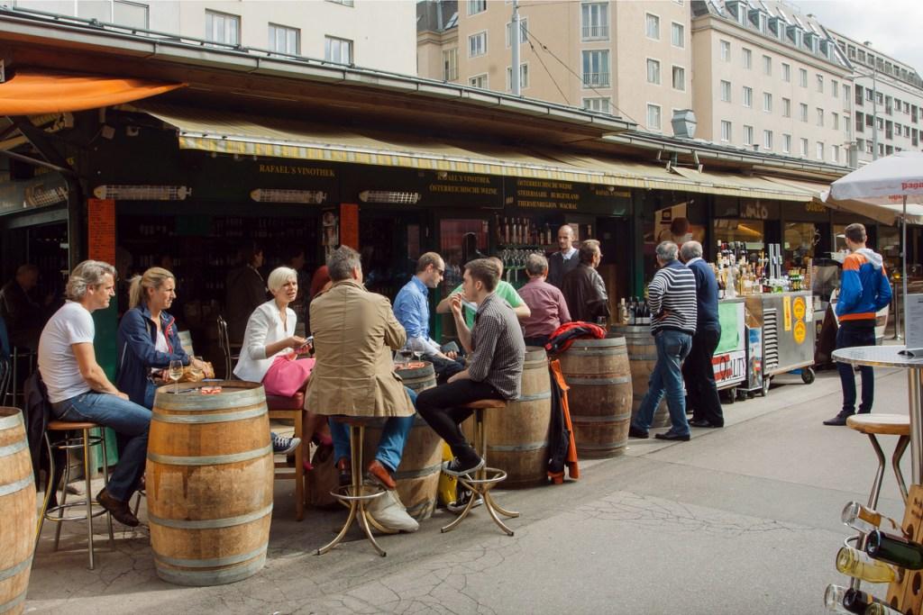 People in outdoor cafe in area of Naschmarkt, Vienna