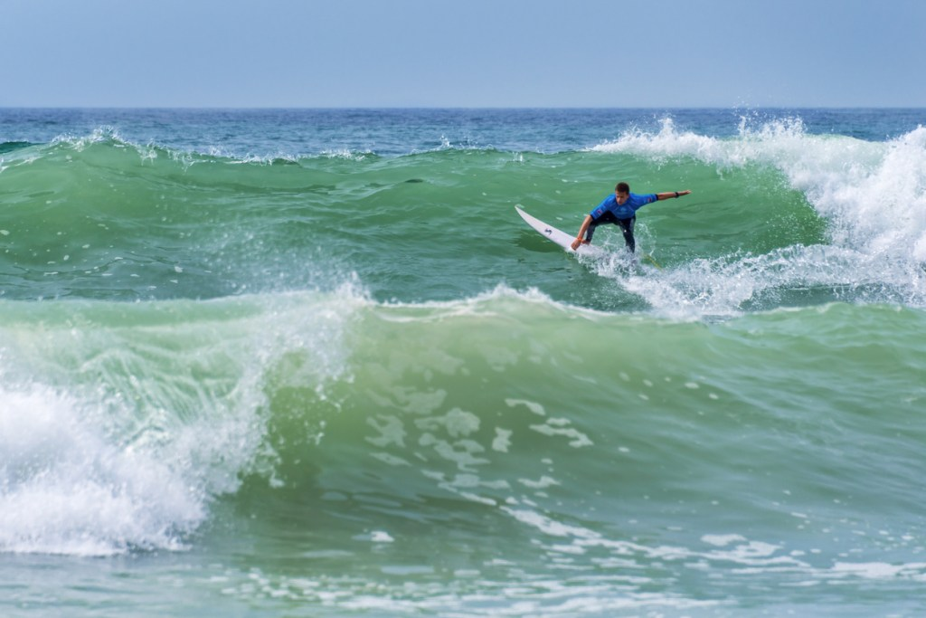 Surfer riding a nice wave during World surf league competition in Lacanau