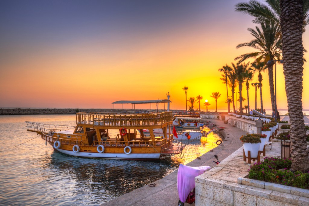 The harbour with boats in Side at sunset, Turkey