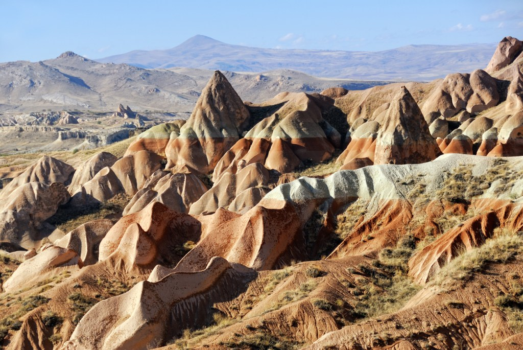 View of Cappadocia. Turkey. Unusual landscape with a cliff at evening time
