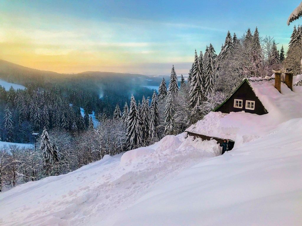 Czech mountains Krkonose landscape in winter in the early morning with lovely small wooden cottage