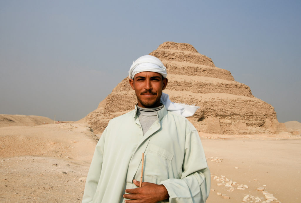 A traditional Egyptian tribesman stands near the Step Pyramid in Saqqara, just outside Cairo