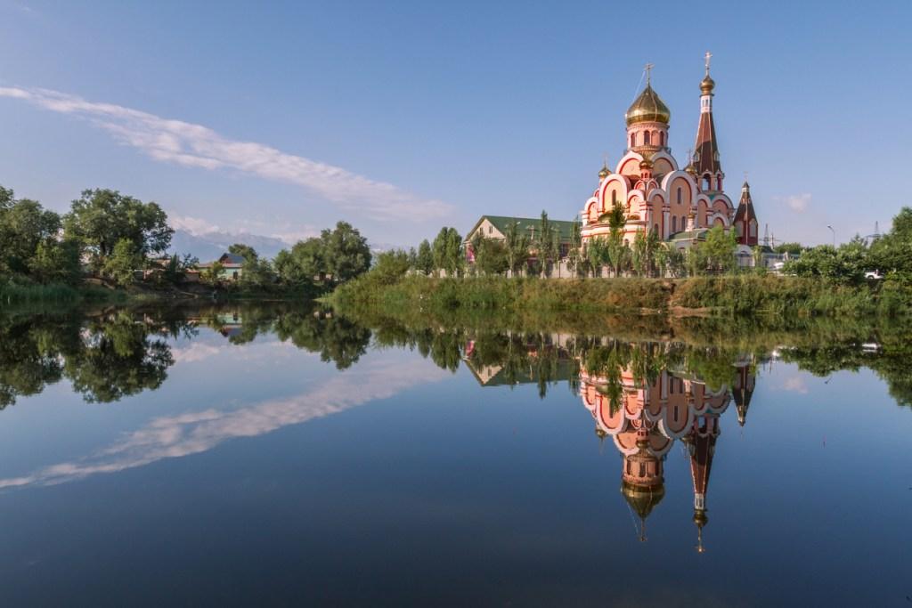 Reflection of a Russian orthodox church in water, in Almaty, Kazakhstan