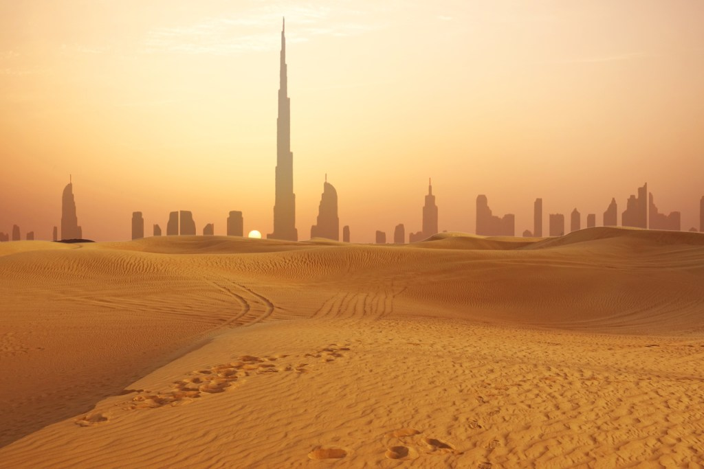 Dubai city skyline at sunset seen from the desert