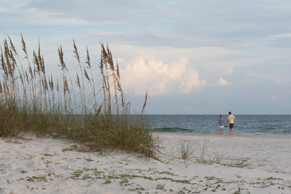 Couple walking on the beach at Gulf Shores State Park