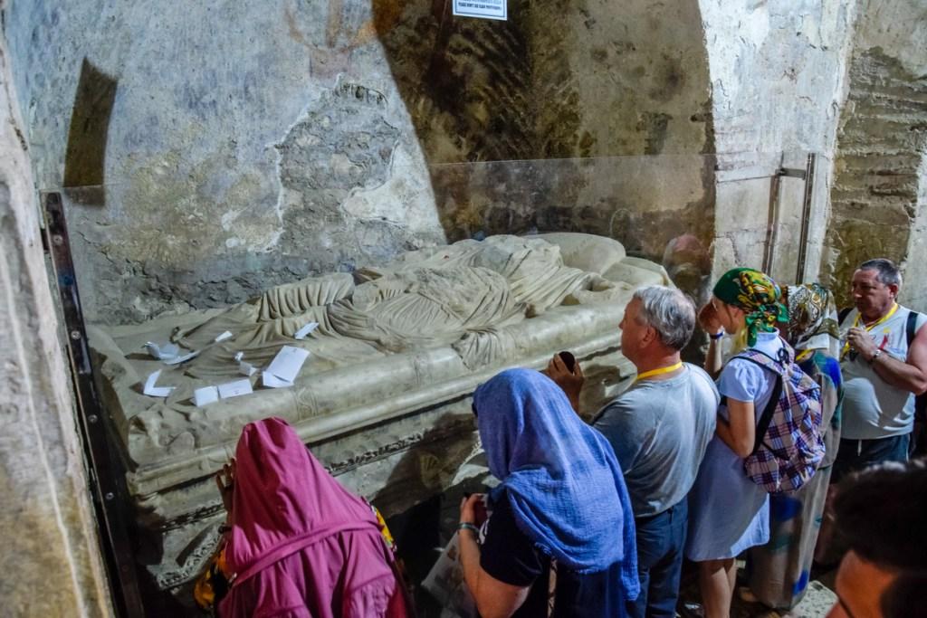 Pilgrims near the sarcophagus of St. Nicholas in Demre, Turkey.