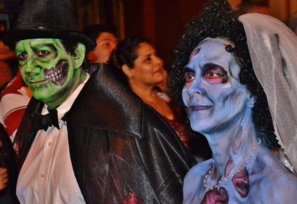 man and woman celebrating Dia de los Murtos in Mazaltan, Mexico