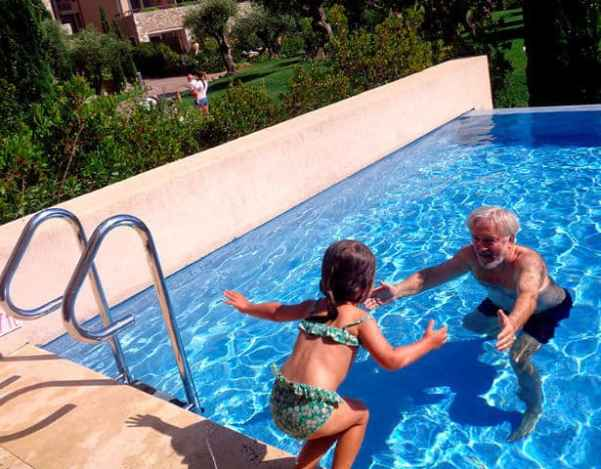 Amalia and Papou playing at the pool in the Westin, Greece