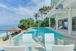 2.-Grand-Cliff-Front-Residence---Dinner-table-pool-side
