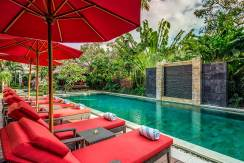 The-Residence,-Seminyak---Villa-Nilaya---Sun-loungers-by-the-pool