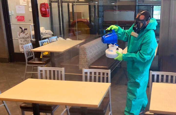 man disinfecting restaurant