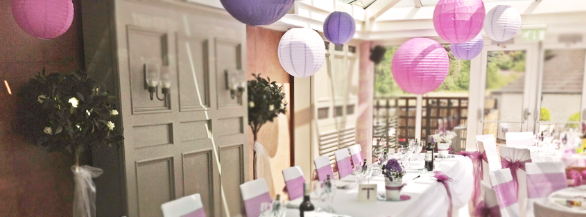 paper chair covers for weddings stand exercise wedding lake district cumbria hanging lanterns and pom poms