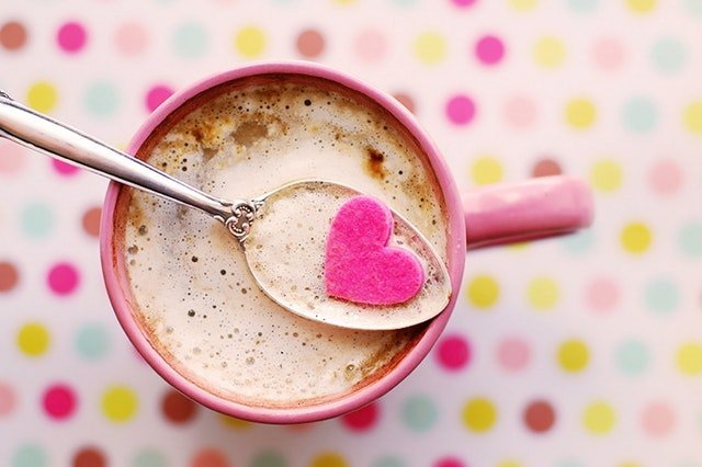 How To Deal With The Fuss On Valentine's Day Coffee Cup with a pin colour heart in spoon, pink background, love, Valentines Day and relationships, purposefulhabits