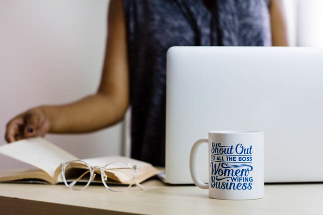 Workplace Success is essential, woman at laptop with a hot drink