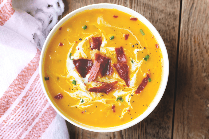 easy vegan carrot and cilantro soup topped with peppers