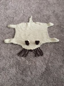Knitted cat rug