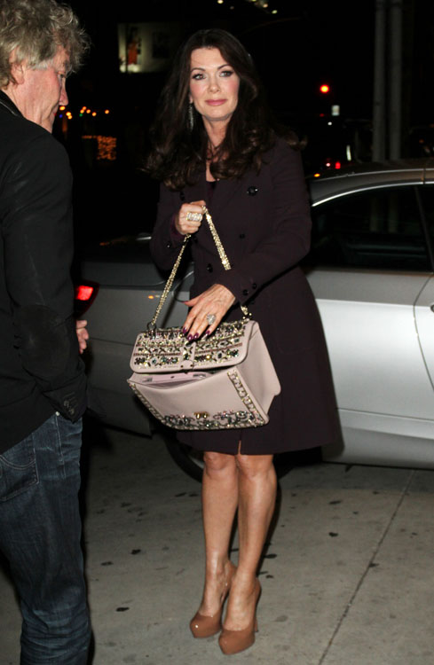 Lisa Vanderpump carries a crystalpacked Valentino