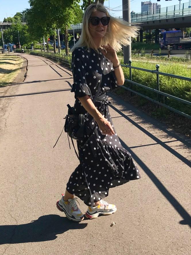 Polka dot dress and Balenciaga Triple S. The feminine dress and dad sneakers.