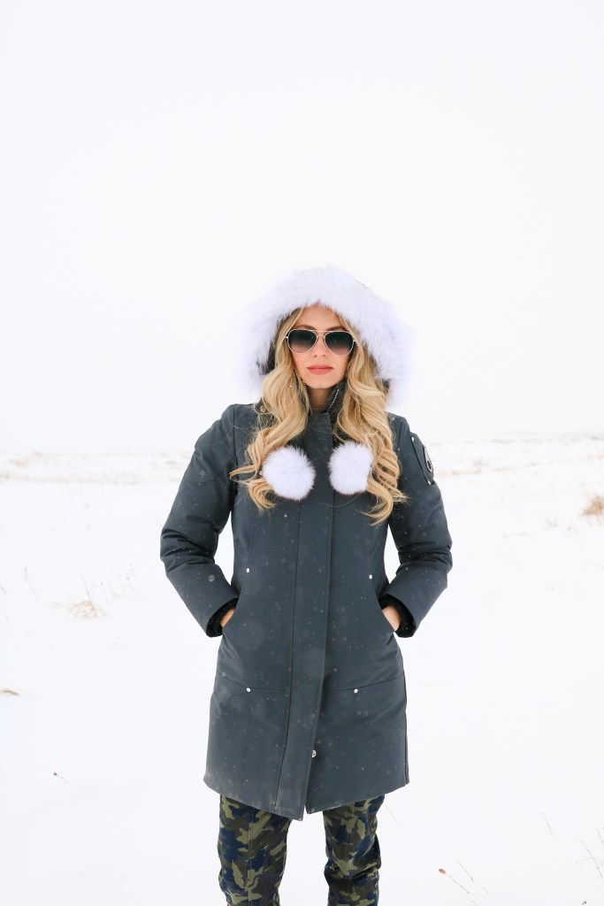 What to wear in Canadian winter: Moose Knuckles Stirling Parka, Emu Boots, aviators. Travel to Canada outfits!