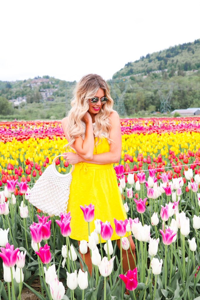 Tulip Festival in Canada - tips on when to go and how to get the best photos! Pursuing Pretty summer fashion trends with Joe Fresh. #style #fashion #travel #canada #flowers #tulips