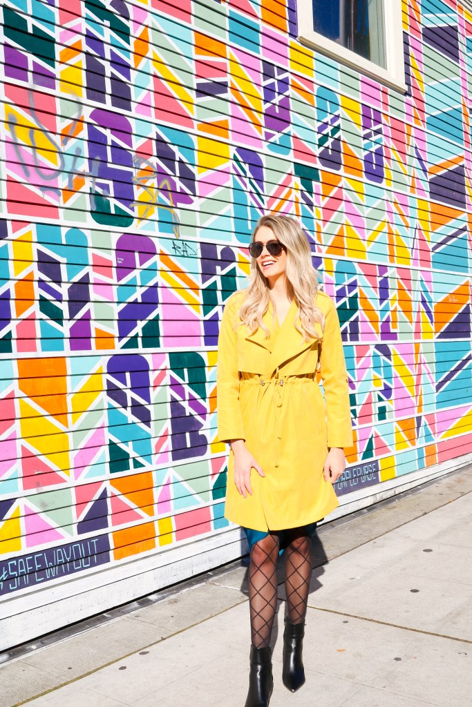 Fall Fashion - mustard trench coat from chicwish - fishnet hose - black boots- black aviators - instagram walls in Seattle - outfit ideas 2019