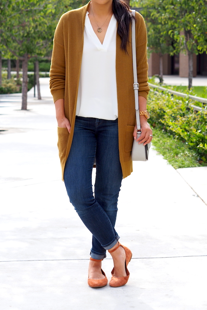 white top + tan cardigan + dark wash jeans + red flats