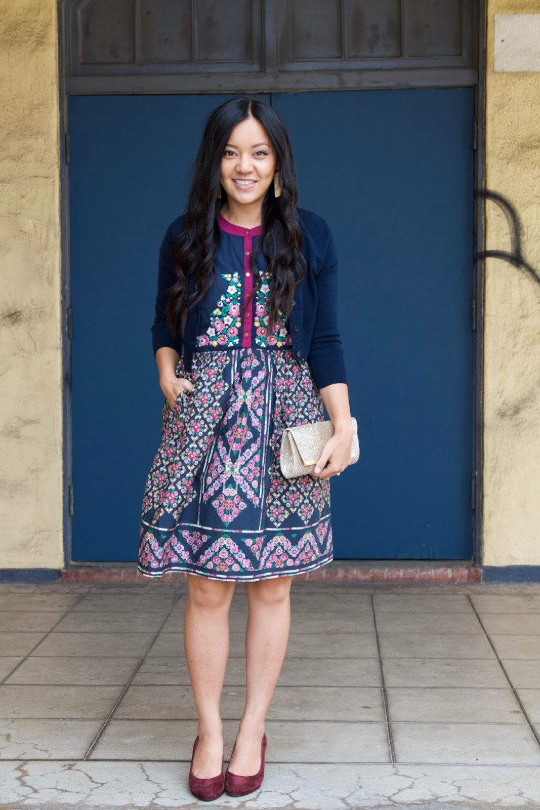 Blue Floral Dress + Navy Cardigan + Gold Clutch + Gold Earrings + Maroon Pumps