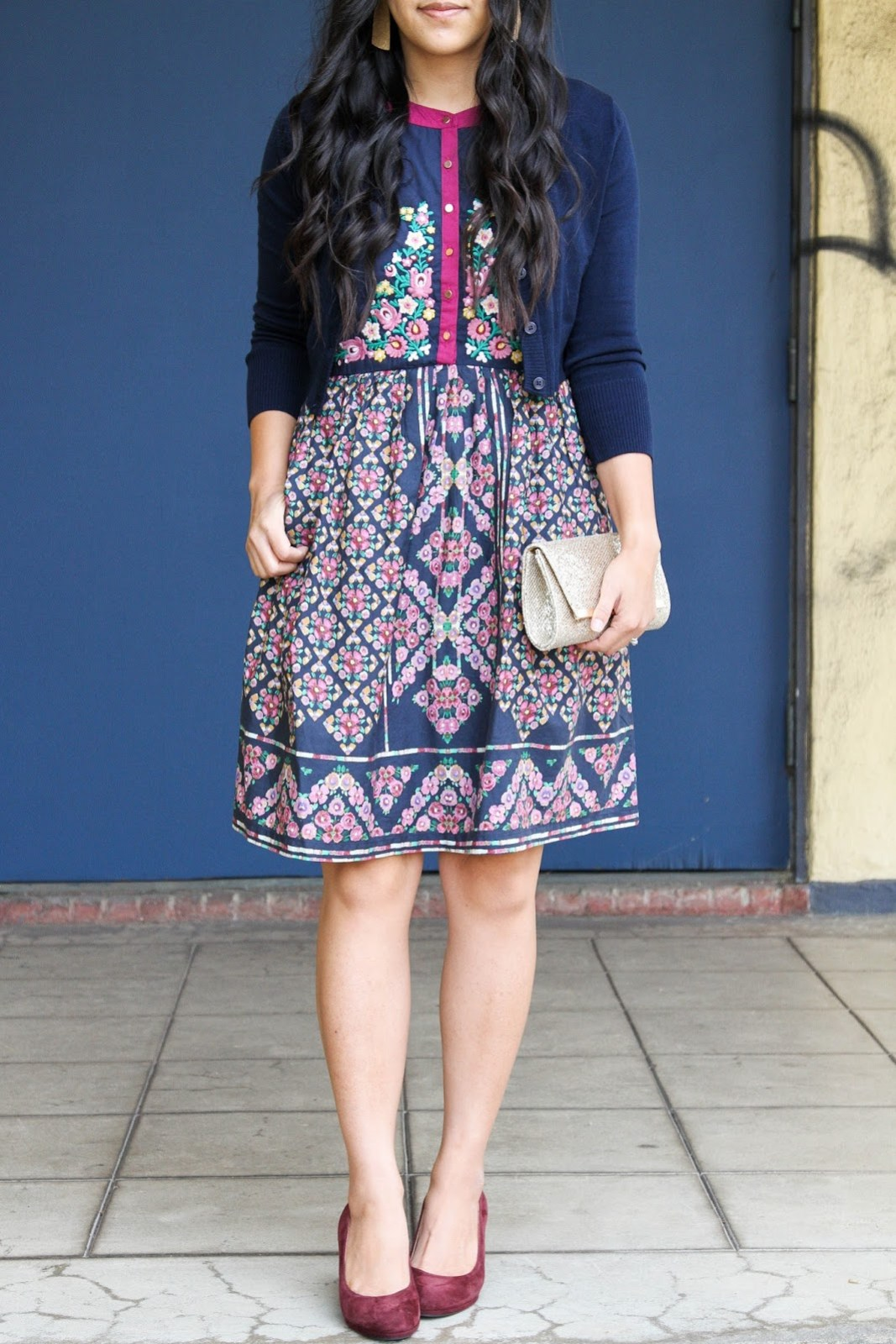 Gold Clutch + Navy Floral Dress + Navy Cardigan + Gold Earrings + Nude Pumps