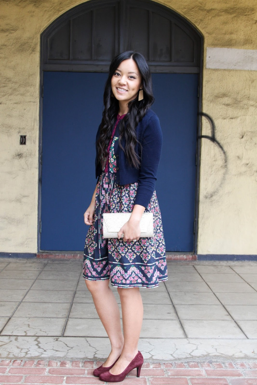 Gold Earrings + Navy Cardigan + Navy Floral Dress + Maroon Pumps + Gold Clutch
