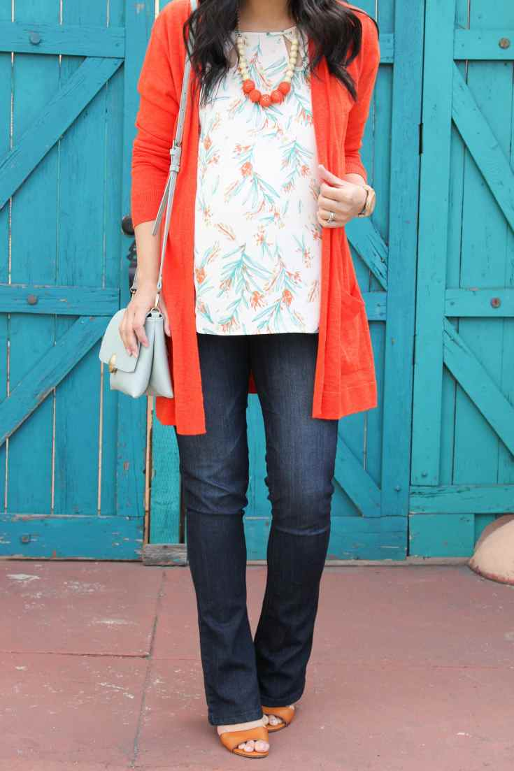 White Floral Blouse + Statement Necklace + Orange Cardigan + Mint Purse + Bootcut Jeans + Wedge Sandals