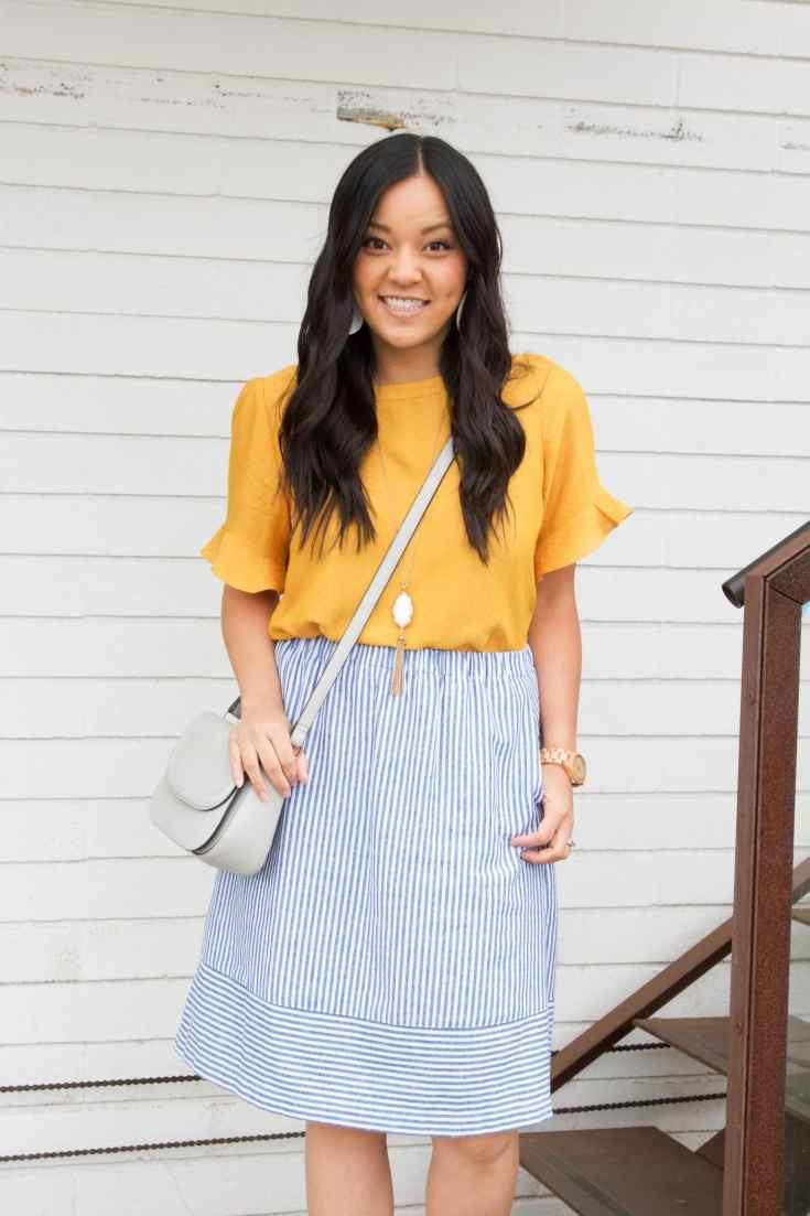 Marigold Blouse + Striped Skirt + Grey Bag + Statement Necklace