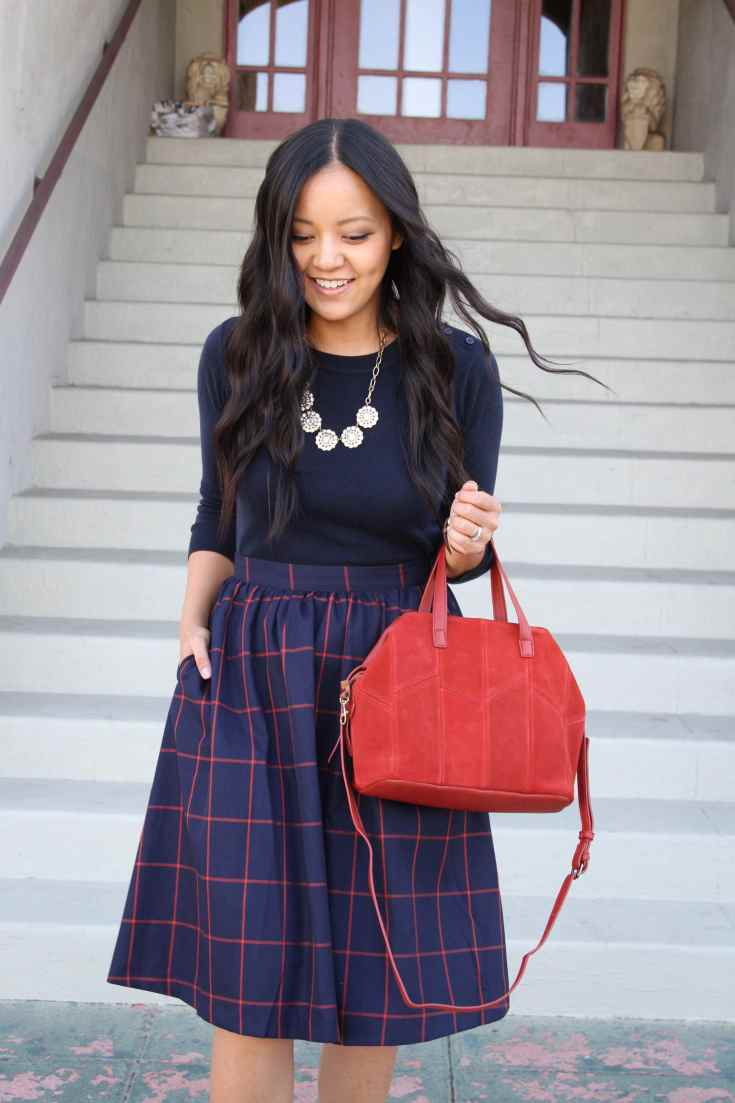 Plaid Skirt + Navy Top + Red Bag + Statement Necklace