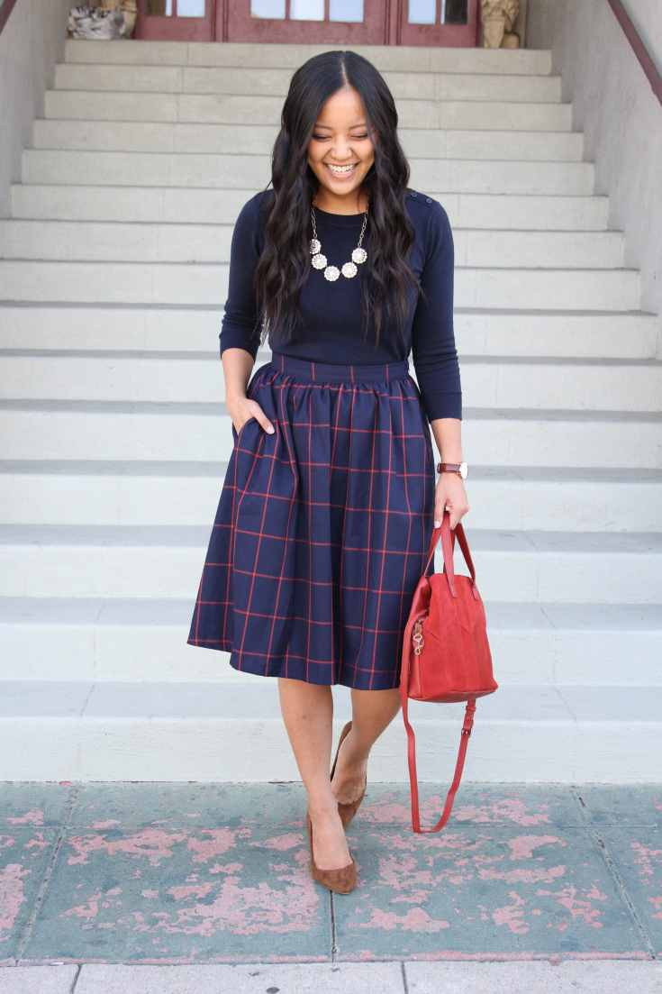Pullover Sweater + Blue midi skirt + Red bag + Pumps + Statement Necklace