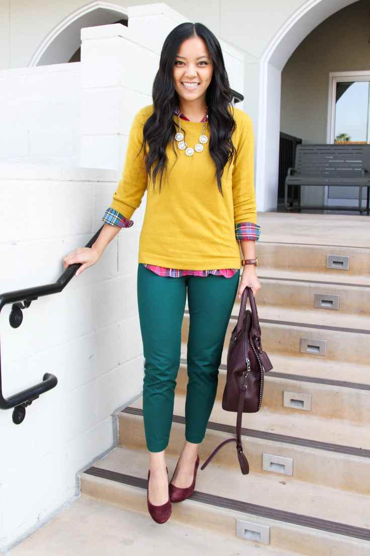 business casual look: yellow pullover + plaid top + statement necklace + green ankle pants