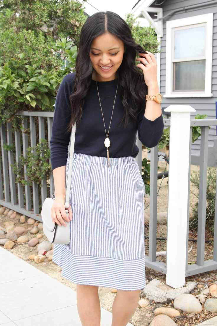 Striped skirt + Navy sweater + Grey bag
