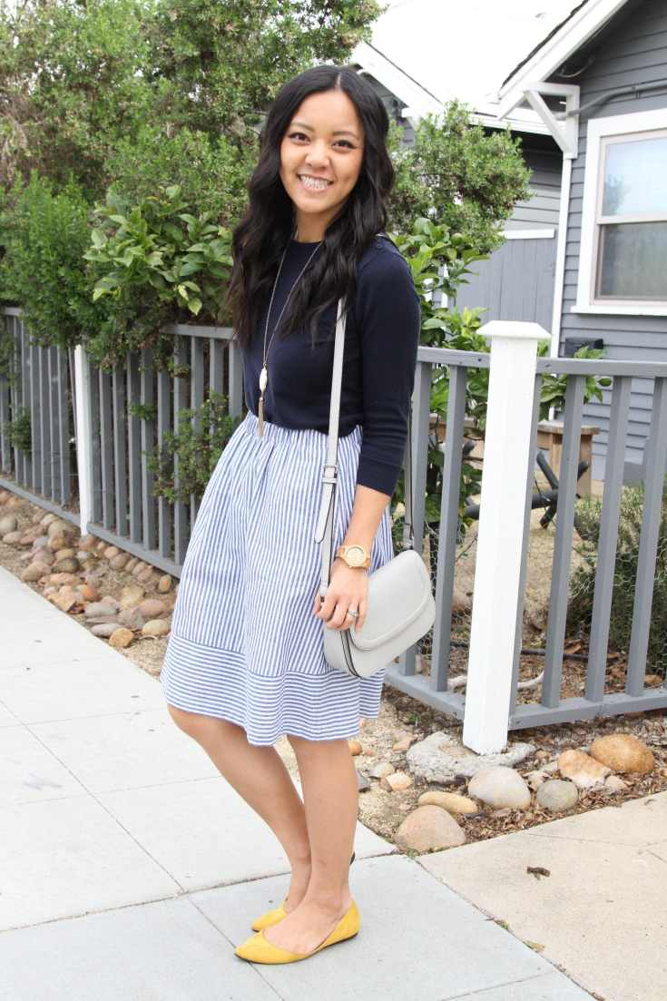 Yellow flats + Navy Sweater + Striped skirt + Grey Bag
