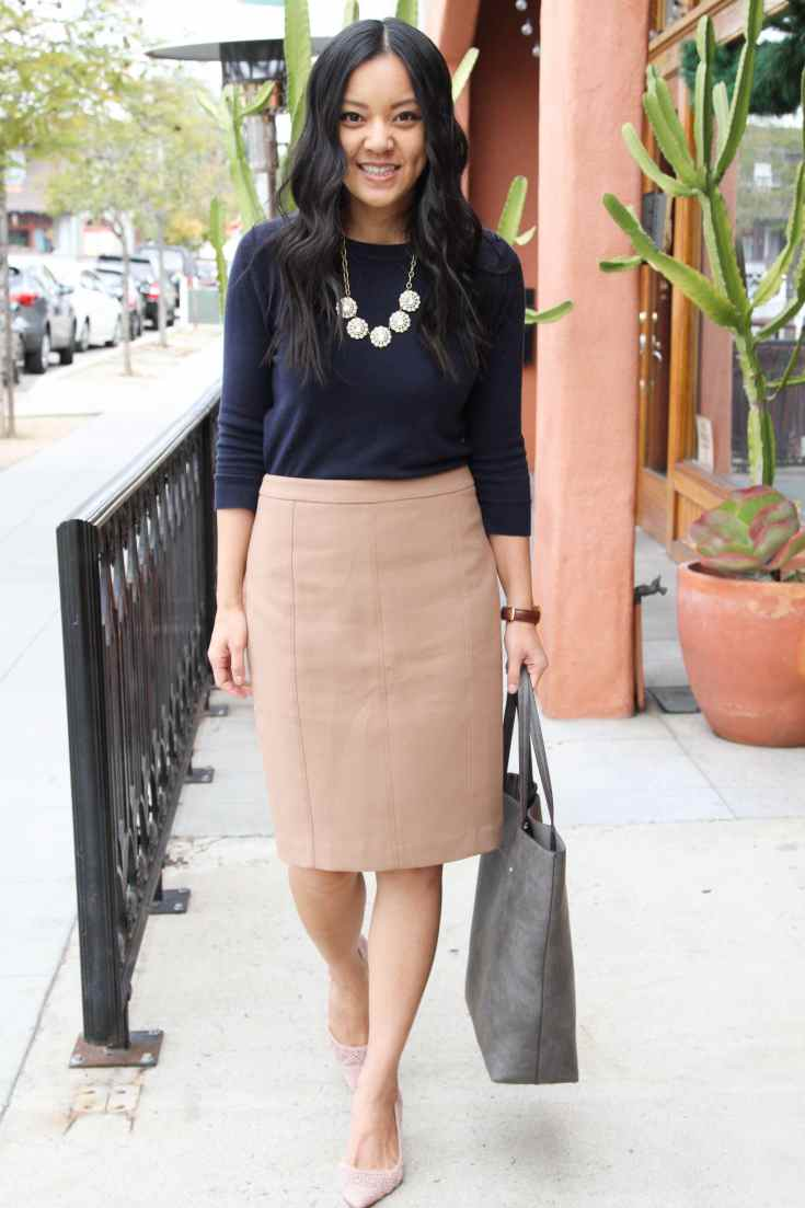 Business Casual Outfit: Navy Sweater + Tan Skirt + Grey Tote + Medallion Necklace + Blush Pumps