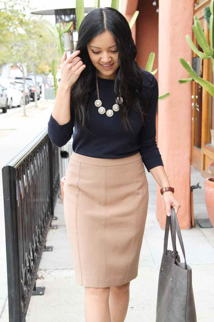 Tan Skirt + Navy Sweater + Grey Tote + Statement necklace